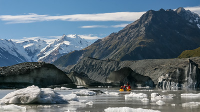 Landscape view of tourist boats cruising amongst the Icebergs in the glacial lake at the foot of the Tasman glacier, Aoraki National Park, New Zealand