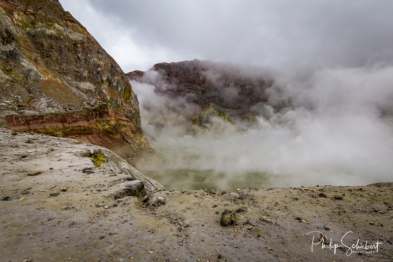 Standing on the edge of the active vents in the crater of White Island Volcano, Bay of Plenty, New Zealand.