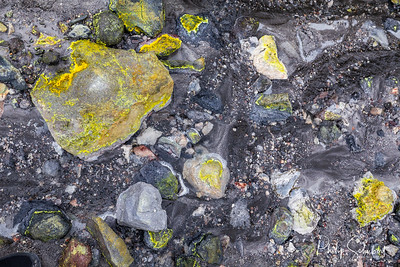 Hot mud and boilng sulphuric acid water on the lahar field, White Island active volcano, New Zealand