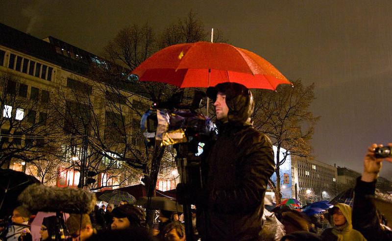 Cameraman with umbrella