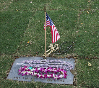 Various Leis Neatly Placed on a Grave