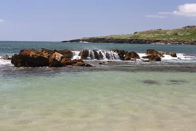 Waves Create Waterfalls Over Rocks in the Ocean