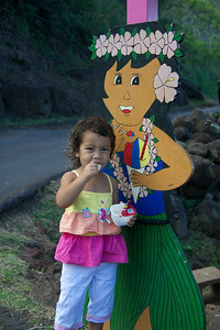 Young Girl Eating Potato Chips with Hula Girl Eating Shave Ice