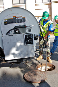 Lowering High Pressure Water Equipment into Sewer Line