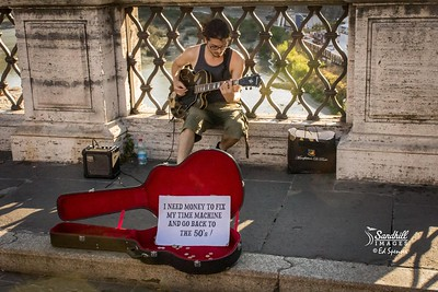 This fellow had such a funny sign. Street busker in Rome