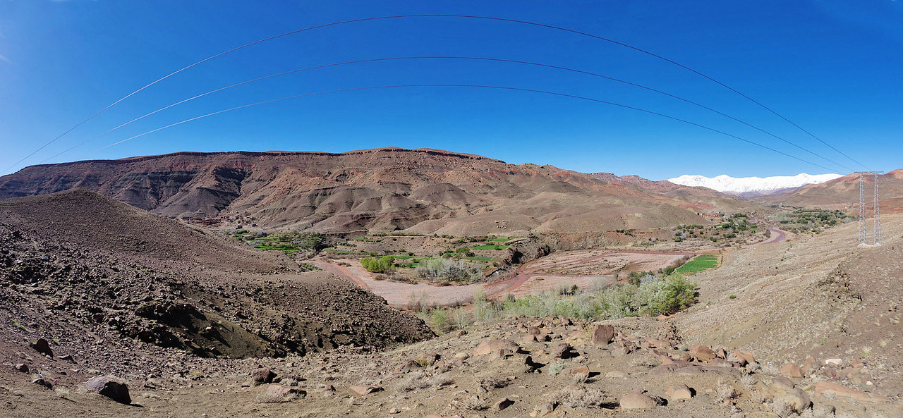 In the Atlas mountains: Valley view with power lines  - on the route from Ouarzazate to Marrakech