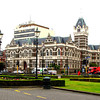 The railway station faces Anzac Square and Dunedin's Law Court's Building.