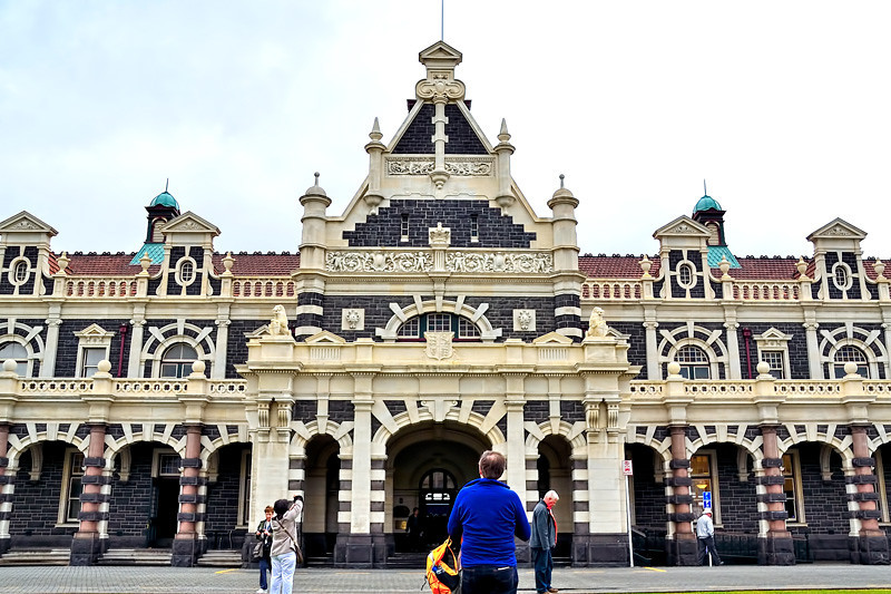 "The front and main entrance to Dunedin Railway Station Building.<br /> <br /> Possibly the best-known building in the southern half of New Zealand's South Island, Dunedin Railway Station is a jewel in the country's architectural crown. Designed by George Troup, the station is the fourth building to have served as Dunedin's railway station. It earned its architect the nickname of ""Gingerbread George""."