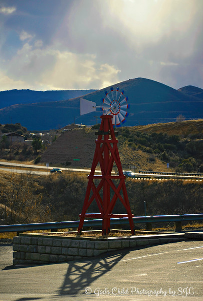 """WHEEL IN THE SKY""<br /> <br /> ""People who make no mistakes lack boldness and the spirit of adventure. They are the brakes on the wheels of progress."" ~ Dale E. Turner<br /> <br /> Known as ""Arizona's country town,"" Dewey-Humboldt was formed in 2004 as a merger of two neighboring communities in the Agua Fria River valley. The combination brought the rich farming culture of Dewey together with Humboldt, a mining community.<br /> <br /> ""Dewey-Humboldt is a town in Yavapai County, Arizona, United States. The population of the town was 3,894 according to the 2010 census. The Dewey-Humboldt area was a census-designated place at the 2000 census, at which time its population was 6,295."" ~ Reprinted from Wikipedia<br /> <br /> Near Humboldt Station <br /> Main Street<br /> Town of Dewey-Humboldt, AZ<br /> <br /> (photo taken 12/25/2014 from the passenger side of the vehicle as we were leaving the town)<br /> <br /> My Homepage:  <a href=""http://www.Godschild.smugmug.com"">http://www.Godschild.smugmug.com</a>"