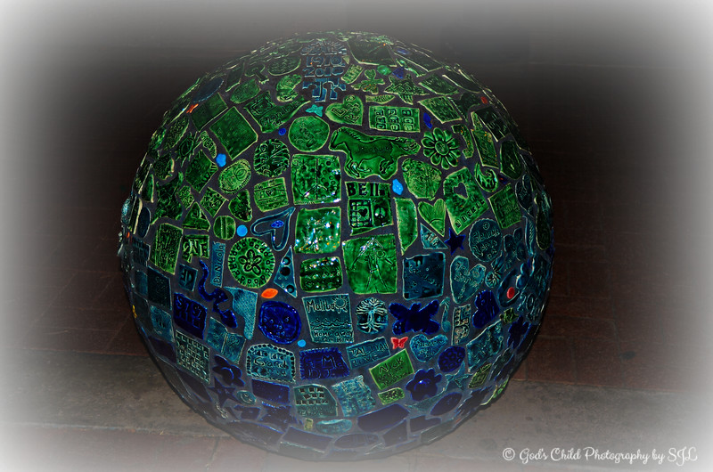 "CENTENNIAL BALL -  created out of tiles made by the public to celebrate the citizens of Glendale, AZ during its centennial celebration in 2010.<br /> <br /> View the post processed version here:<br /> <br /> <a href=""http://godschild.smugmug.com/DailyPhotos/Daily-Dose-of-One-A-Day-2014/i-MrzsVpv/A"">http://godschild.smugmug.com/DailyPhotos/Daily-Dose-of-One-A-Day-2014/i-MrzsVpv/A</a><br /> <br /> Glendale, AZ is also the hometown of Jordin Brianna Sparks, the sixth season American Idol winner on May, 23 2007, who at age 17, became the youngest winner in the series' history.<br /> <br /> Glendale Glitters and Glow <br /> Glendale Glitters Annual Event<br /> Murphy Park @Historic Downtown Glendale<br /> Glendale, AZ<br /> <br /> (photo taken 12/23/2014)"