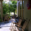 """""""THE PORCH""""<br /> <br /> """"The porch is like the brim of a hat. it shades you, but makes it possible for you to have an uninterrupted view of the surrounding landscape."""" ~ David Heymann (American Architect)<br /> <br /> My hubby and I ate here while in town on business. I had read great reviews the day before and we decided to give it a try. The food was OK but the service was attentive, although not intrusive. <br /> <br /> Also, when I titled this photo, I was reminded of one of my absolute favorite television shows: """"Betty White's: Off Their Rockers,"""" a series, which ran for two seasons, and featured  White overseeing the elderly playing pranks on younger folks in a hidden-camera fashion similar to """"Candid Camera."""" The show launched with a preview in April 2012 timed to an NBC special tribute for White's 90th birthday earning 12 million total viewers. Following its 12-episode run from January to May 2012, NBC renewed the series for a second run of 14 installments, which started with back-to-back airings in January into February 2013 with its final four episodes airing March 19, June 25 and July 9, 2013.<br /> <br /> The official website/link to the show is here: <br /> <br /> <a href=""""http://www.nbc.com/betty-whites-off-their-rockers"""">http://www.nbc.com/betty-whites-off-their-rockers</a><br /> <br /> """"Two Sister's Kitchen whips up its signature fried chicken—lauded by Travel Channel and Food & Wine magazine as among the best in the country—in the kitchen of a historic home built in 1902. Six days a week, buffets and chafing dishes serve catfish, cornbread, biscuits, tomato gravy, and other Southern eats. Tables draped in flowered cloths fill the house's cozy dining rooms, and wrought-iron furniture crowns the outdoor patio. The front porch looks out at the capitol building, which serves as a reminder to abide the law about chewing with your mouth closed."""" ~ Reprinted text from here: <br /> <br /> <a href=""""https://www.groupon.com/biz/jackson/two-sisters-kitchen"""">ht"""