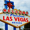 "July 11, 2013<br /> <br /> The Front of the Famous ""WELCOME TO FABULOUS LAS VEGAS, NEVADA"" Sign<br /> <br /> I always regretted not getting to see and photograph this iconic sign during my visit in 2006, but I was determined not to leave Las Vegas without a photograph of it during this visit. We posed in front of it, also. Darn, those wires!<br /> <br /> ""Located on the Las Vegas Strip just south of Russell Road, the sign famously reads, ""Welcome to Fabulous Las Vegas, Nevada"" on the front and ""Drive Carefully"" and ""Come Back Soon"" on the back. The sign was designed by Betty Willis (who never sought a trademark) while she worked for Western Neon Company and cost $4,000 to build and install. Willis also designed the iconic signs for the Moulin Rouge hotel. It's original creation was inspired by her father, Las Vegas pioneer S.R. Whitehead, Clark County's first tax assessor, who died 18 years before the sign went up. ""Dad was so strong on getting people to come here,"" Willis told the Las Vegas Sun in 2005. ""I think my dad would be proud of what the sign has accomplished. On May 1, 2009, the ""Welcome to Las Vegas"" sign was added to the National Register of Historic Places."" <br /> <br /> Reprinted texts from here: <br /> <br /> <a href=""http://www.vegas.com/attractions/on-the-strip/welcome-las-vegas-sign/"">http://www.vegas.com/attractions/on-the-strip/welcome-las-vegas-sign/</a><br /> <br /> 5200 Las Vegas Blvd.<br />  Las Vegas, NV"