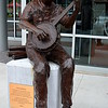 """RICK REDDEN"" SCULPTURE (2013)<br /> <br /> ""The final proof of greatness lies in being able to endure criticism without resentment."" ~ Elbert Hubbard<br /> <br /> Banjo in one hand, blueprints behind him.....<br /> <br /> The inscription on the plaque reads: ""In memory of a wonderful man, architect, musician, and friend. His gifts to Little Rock are many. He will be missed, but never forgotten."" ~ Given by his friends at Moses Tucker Real Estate and The Central Arkansas Library System Endowment<br /> <br /> River Market District<br /> Little Rock, AR<br /> <br /> (photo taken 5/17/2014)"