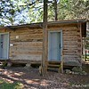 """September 3, 2016<br /> <br /> """"KOY CABIN"""" (circa 1889)<br /> <br /> """"There are elements of intrinsic beauty in the simplification of a house built on the log cabin idea."""" ~ Gustav Stickley<br /> <br /> """"Moved to the Village intact in 1991, the Koy Cabin was owned by August Koy, Casner Township, 1889. It houses a collection of cooking stoves from the late 19th century through the early 20th century."""" <br /> <br /> """"The Village"""" contains both original buildings and restorations primarily from the late 1800's through the early 1900's. Among the buildings and exhibits are: operating printing shop, log homes, log church, 1820 calaboose (jail)<br /> windmill & grist mill, and a working blacksmith shop.<br /> <br /> ~ Reprinted text from here:<br /> <br /> <a href=""""http://jchs.mvn.net/Village.html"""">http://jchs.mvn.net/Village.html</a><br /> <br /> Jefferson County Historical Village Museum<br /> 1411 North 27th St.<br /> Mt Vernon, IL 62864<br /> Telephone Number: (618) 246-0033<br /> Official Website: <a href=""""http://jchs.mvn.net"""">http://jchs.mvn.net</a><br /> <br /> My Homepage: <br /> <br />  <a href=""""http://www.GodsChild.SmugMug.com"""">http://www.GodsChild.SmugMug.com</a>"""