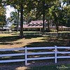 "September 22, 2015<br /> <br /> ""SOUTHERN LIVING""<br /> <br /> ""There is peace and tranquility that can be found in the country."" ~ Author Unknown<br /> <br /> I have passed this humongous residence several times and never took photos of it. It's Southern and country living at its best. Can't you envision people riding horses within those white, picket fences? I can!<br /> <br /> ""Only a True Southerner ..."" <br /> <br /> Knows the difference between a ""hissie fit"" and a ""conniption,"" and that you don't ""HAVE"" them, you ""PITCH"" them. Knows how much any fish, collard greens, turnip greens, peas, beans, etc. make up ""a mess"" (as in ""a mess"" of greens). Only a true southerner can show or point out the general direction of ""yonder."" Only southerners know exactly how long ""directly"" is ... as in, ""Going to town, be back directly."" (Generally pronounced ""dreckly""). All true Southerners, even babies, know that ""Gimme some sugar,"" is not a request for the white, granular sweet substance that sits in a pretty little bowl on the middle of the table. All true Southerners know exactly when ""by and by"" is. They might not use the term, but they know the concept well.""<br /> <br /> ""A true Southerner knows that ""fixin"" can be used as a noun, a verb, or an adverb. (As in, I was fixin' to go over to BettyLou's. Or, we had a huge Christmas dinner with all the fixins. Or, are you fixin' my car next?). Only true Southerners make friends while standing in lines. We don't do ""queues,"" we do ""lines,"" and when we're IN, not ON, line we talk to everybody! True Southerners never refer to only one person as ""y'all"".... more than three is way more than one, it''s ""all y'all."" Only true Southerners say ""sweet tea"" and ""sweet milk."" ""Sweet tea"" indicates it contains sugar and lots of it ... we do not like our tea unsweetened. ""Sweet milk"" means you don't want buttermilk. And a true Southerner knows you don't scream obscenities at little old ladies who drive 30 MPH on the freeway. You just say, ""Bless her heart!"" and go your own way."" <br /> <br /> ~ Excerpt from observations by Theresa Whice Olah here:<br /> <br /> <a href=""http://freepages.genealogy.rootsweb.ancestry.com/~crackerbarrel/True.html"">http://freepages.genealogy.rootsweb.ancestry.com/~crackerbarrel/True.html</a><br /> <br /> Hwy 17<br /> Kilbourne, LA<br /> <br /> My Homepage:  <a href=""http://www.GodsChild.SmugMug.com"">http://www.GodsChild.SmugMug.com</a>"