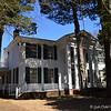 """ROWAN OAK""<br />  Old Taylor Road<br />  Oxford, MS<br />  <br /> Official website is here:  <a href=""http://www.rowanoak.com"">http://www.rowanoak.com</a><br /> <br /> Home to William Faulkner and his family for over 40 years, Rowan Oak was originally built in 1844, and stands on over 29 acres of land just south of the Square in Oxford, MS. <br /> <br /> ""Rowan Oak is a Historic Home located on Old Taylor Road, Oxford, Mississippi. The previous address of the house was 719 Garfield roads, in the 1980's the street names were changed. Rowan Oak is also known as William Faulkner House as it was the former home of William Faulkner. The house was built in the 1840's and purchased by Faulkner in the 1930's and completed the majority of renovations himself. He furnished the house antiques and created an office where he kept his writing tools.""<br />  <br /> ""The house is a large two story white frame home on land that is a large 29 acres of wooded land known as Bailey's Woods, and the house occupies only four landscaped acres. The house received more renovations in the 1950's. The house is known for its famous features which is the outline of Faulkner's Pulitzer Prize winning novel A Fable.""<br />  <br /> ""The grounds and surrounding woods contain hundreds of native Mississippi plants; the driveway is lined with an alley of cedars which was common practice in the 1800's. Rowan Oak is a mythical tree which Faulkner used as inspiration for the multi layered time from Rowan Oak where the past and future seem to inhabit the presents. The studs of the house are hand-hewn square cypress.""<br />  <br /> ""The house was sold to the University of Mississippi in 1972 by William Faulkner's daughter, Jill Faulkner Summers. The home is used by the University to promote Faulkner's literary heritage and in 1968 was declared a National Historic Landmark. The house received some slight renovations that were funded by oxford resident John Grisham and was rededicated in May 2005."" <br /> <br /> ""Tours of the house show visitors behind the house where the stable and cooks house are located along with the smokehouse and the preserved gardens. The house has been visited by many accomplished writers over the years including Charles Wright, Alice Walker, Salman Rushdie and John Updike. When author Mark Richard visited Rowan Oak her repaired the faulty doorknob on the French door that led to Faulkner's Study.""<br /> <br /> ~ Reprinted text from here: <a href=""http://www.city-data.com/articles/Rowan-Oak-is-the-historic-home-of-author.html#ixzz2NTrwcYNjOfficial"">http://www.city-data.com/articles/Rowan-Oak-is-the-historic-home-of-author.html#ixzz2NTrwcYNjOfficial</a> website: <a href=""http://www.rowanoak.com/"">http://www.rowanoak.com/</a><br />  <br /> (photo taken 3/13/2013)"