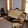 """THE PARLOR"" at Rowan Oak<br /> Old Taylor Road<br /> Oxford, MS<br /> <br />  Official website is here: <a href=""http://www.rowanoak.com"">http://www.rowanoak.com</a><br />  <br /> Home to William Faulkner and his family for over 40 years, Rowan Oak was originally built in 1844, and stands on over 29 acres of land just south of the Square in Oxford, MS. <br /> <br /> ""Rowan Oak is a Historic Home located on Old Taylor Road, Oxford, Mississippi. The previous address of the house was 719 Garfield roads, in the 1980's the street names were changed. Rowan Oak is also known as William Faulkner House as it was the former home of William Faulkner. The house was built in the 1840's and purchased by Faulkner in the 1930's and completed the majority of renovations himself. He furnished the house antiques and created an office where he kept his writing tools.""<br /> <br />  ""The house is a large two story white frame home on land that is a large 29 acres of wooded land known as Bailey's Woods, and the house occupies only four landscaped acres. The house received more renovations in the 1950's. The house is known for its famous features which is the outline of Faulkner's Pulitzer Prize winning novel A Fable.""<br /> <br />  ""The grounds and surrounding woods contain hundreds of native Mississippi plants; the driveway is lined with an alley of cedars which was common practice in the 1800's. Rowan Oak is a mythical tree which Faulkner used as inspiration for the multi layered time from Rowan Oak where the past and future seem to inhabit the presents. The studs of the house are hand-hewn square cypress.""<br /> <br />  ""The house was sold to the University of Mississippi in 1972 by William Faulkner's daughter, Jill Faulkner Summers. The home is used by the University to promote Faulkner's literary heritage and in 1968 was declared a National Historic Landmark. The house received some slight renovations that were funded by oxford resident John Grisham and was rededicated in May 2005."" <br /> <br /> ""Tours of the house show visitors behind the house where the stable and cooks house are located along with the smokehouse and the preserved gardens. The house has been visited by many accomplished writers over the years including Charles Wright, Alice Walker, Salman Rushdie and John Updike. When author Mark Richard visited Rowan Oak her repaired the faulty doorknob on the French door that led to Faulkner's Study.""<br />  <br /> ~ Reprinted text from here: <a href=""http://www.city-data.com/articles/Rowan-Oak-is-the-historic-home-of-author.html#ixzz2NTrwcYNjOfficial"">http://www.city-data.com/articles/Rowan-Oak-is-the-historic-home-of-author.html#ixzz2NTrwcYNjOfficial</a> website: <a href=""http://www.rowanoak.com/"">http://www.rowanoak.com/</a><br /> <br />  (photo taken 3/13/2013)"