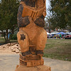 "October 24, 2015 at ""Great Delta Bear Affair"" 2015<br /> <br /> ""LIBRARY BEAR"" by Dayton and Scoggins (father-son chainsaw woodcarvers)<br /> <br /> With a book in his hand, ""Library Bear"" was moved to the grounds of the Sharkey-Issaquena County Library days after this year's ""Great Delta Affair"" last month. <br /> <br /> After a visit in October, we had to return to see the latest addition to bears around the town - although we missed the actual carving of this one. Shown here is ""Library Bear"" and after the Delta Bear Affair, he was relocated to the public library in the city.<br /> <br /> ""In 1902, President Theodore Roosevelt and famed guide Holt Collier came to the area for a black bear hunt. The expedition was unsuccessful but Roosevelt was offered the opportunity to shoot a captive bear at the end of the hunt but he refused; resulting in the naming of stuffed toy bears as ""Teddy Bears.""  <br /> <br /> ""Rolling Fork celebrates Teddy Roosevelt and his legacy on the fourth Saturday in October for the Great Delta Bear Affair.  Also, each year of the festival, the town receives a new sculptor of a chainsaw carved wood bear from the festival artist. These wooden masterpieces can be found at various locations throughout town. The 12 foot wooden bears are carved during the Great Delta Bear Affair. It's great fun to watch a bear being formed from a cypress tree stump by renowned Mississippi chainsaw woodcarver, Dayton Scoggins.""<br /> <br /> ""The Great Delta Bear Affair was first observed in 2002 on the 100th anniversary of President Theodore Roosevelt's famous bear hunt in Sharkey County, Mississippi. The Bear Hunt led to the creation of the Teddy Bear. Since that time it has become an annual event embraced by the community and filled with great entertainment. Continuous musical acts, a tour of nearby archaeological sites, seminars, a chainsaw wood carver, arts and crafts vendors, magician, food vendors, Teddy Roosevelt and Holt Collier impersonators and lots of friendly folks highlight this first class festival held on the courthouse square in Rolling Fork.""<br /> <br /> Great Bear Delta Affair<br /> Courthouse Square<br /> Rolling Fork, MS<br /> Official website: <a href=""http://www.greatdeltabearaffair.org"">http://www.greatdeltabearaffair.org</a><br /> <br /> My Homepage:  <a href=""http://www.GodsChild.SmugMug.com"">http://www.GodsChild.SmugMug.com</a>"