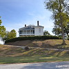 """October 17, 2015<br /> <br /> View of the side of the house as we were leaving...<br /> <br /> """"MONT HELENA is a Colonial revival style home built atop a ceremonial Indian mound in the Mississippi Delta. In 1896, Helen Johnstone Harris and her husband, George Harris built their """"retirement"""" house on land that Helen had inherited. When the home was completed, the Harrises had their furnishings brought by rail from their previous home in Madison, MS. Fortunately those items were still on the train when fire completely destroyed the new house. Undaunted, Helen and George began rebuilding.""""<br /> <br /> """"The house was designed by George Barber, an architect, most famous for his Queen Anne Victorian style house plans. During its early years, Mont Helena was one of the premier homes of the Delta.""""<br /> <br /> The love story goes like this......<br /> <br /> """"In 1855 a carriage accident caused a chance meeting between Helen Johnstone of Annandale Plantation (near present day Madison, MS) and Henry Vick of Nitta Yuma, MS. There was an immediate attraction between Helen and Henry. A courtship began and in 1857 they became engaged. Helen's mother insisted they wait until Helen's 20th birthday to marry. The wedding date was set for May 21, 1859 (Helen's birth date.) In 1859 at a bachelor party for Henry an argument ensued between Henry and his best friend, James Stith. Henry had sided with a servant causing James to vow to never speak to Henry again.""""<br /> <br /> """"While Henry was in New Orleans one week before the wedding finalizing plans, Henry and James had a chance encounter. James, still angry with Henry, challenged him to a duel. The next morning the two met on the dueling grounds. During his courtship with Helen, Henry had made a promise to never kill an opponent in a duel. Keeping his promise to Helen Henry shot into the air. But, James shot and killed Henry. Henry's body was returned to Annandale a little after midnight on May 21, 1859. He was buried in the Johnstone"""