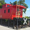 """September 3, 2016<br /> <br /> """"The Red Caboose""""<br /> <br /> """"The Red Caboose was originally donated to the  Sikeston Depot Museum in 2001 by the Don Lowe Family. It quickly became a downtown city landmark. """"Go down Malone to the big red caboose and make a right""""…  """"Go to the Caboose and make a left"""" … """"Go west to the caboose and you're there."""" That's how most people get directions to downtown Sikeston, Three Rivers College, or the Depot Museum. But that icon was in trouble. Fifty years in the sun, rain, and snow has taken its toll.""""<br /> <br /> """"Early in the summer of 2013, major roof problems were discovered.  Looking into repairs led to an even bigger issue of  major structural concerns throughout the caboose. Repairs made in September of 2013 served as a """"band-aid"""" to support the structural integrity temporarily, but much more was needed.""""<br />  <br /> A phone call from Linsey Gillespie, a concerned citizen who had fond memories of the caboose, led to a """"Save Our Caboose"""" birthday party for her son, Robbie. Her birthday plans soon snowballed into a fundraising project to rebuild and preserve the beloved landmark.""""<br />  <br />  """"Robbie's Birthday party raised $2,000 thanks in large part to a donation from Jimmy Woods and Hi-Tech Communication. This money provided a huge step in the right direction toward rebuilding the caboose. Later donations, including a sizable donation from the Sikeston Lions Club, made going ahead with the project possible."""" <br /> <br /> """"In the Spring of 2014 the Depot contracted with Hickman Construction to restore the deteriorating caboose. Once the project was underway, it was determined that the structure was too far gone for restoration and instead was rebuilt.  The cost actually exceeded the amount contracted. However, Eddie Hickman - owner of Hickman Construction, finished the work by donating the remaining time and materials as a way to give back to the community.  Hopper Roofing coordinated with Hickman Construction in the co"""