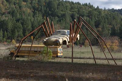 2015_11_03_Oregon misc, Wolf Creek car sculptures, misc motels and signage, caveman sculpture, garden lamp etc.