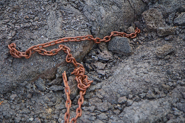Gate chain  disapears into the lava.