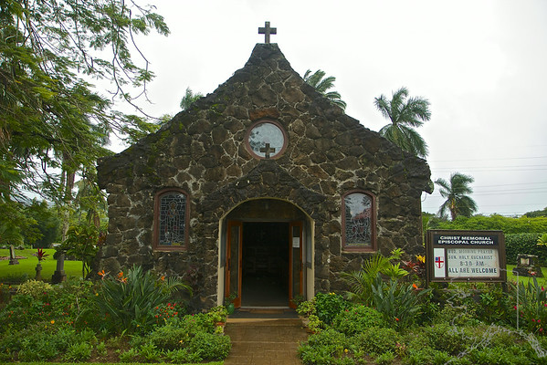 There is also an interesting history attached to the church itself. As early as 1888 worship services were held in Kilauea under the direction of lay leadership and Bishop Willis. Bishop Willis had been sent to Hawai`i by the Church of England and on occasion confirmed people in Kilauea. By 1924 the time had come for a permanent church in Kilauea, and under the leadership of Bishop LaMothe and the Rev. Henry Wyllie, Episcopalians in the area started worshipping in a frame building owned by the Hawaiian Congregational Church.  In 1939 the Kilauea Sugar Company deeded the churchyard to Christ Memorial Church and gave the native stone used in the erection of the present building. The chief benefactor, however, was Mrs. Robert Shapard, of Griffin, Georgia, in memory of her husband, and on the Second Sunday after Epiphany on January 19, 1941 The Right Rev. Harrington Littell consecrated the church.  The graveyard surrounding the church dates back to the earliest days of the original Hawaiian Congregational Church, with many graves dating back over 100 years. Unfortunately, many graves are unmarked and the number of people buried here will probably remain a secret known only to God.