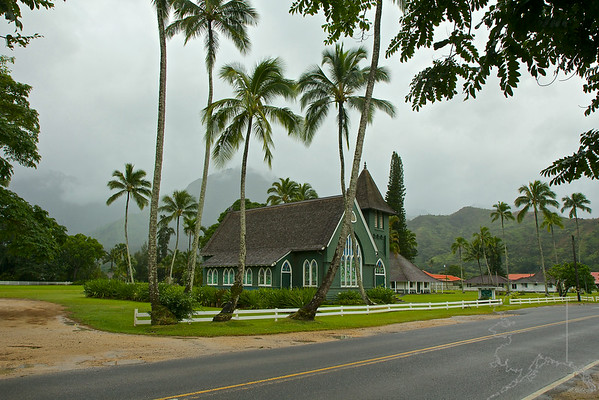 "The Wai`oli Mission was established by American Christian Missionaries in 1834. A pole and thatch meeting house was constructed by Hawaiians on the Mission Hall site, in anticipation of the arrival of the missionaries.      Following the destruction of two earlier buildings by fire and wind, the congregation completed the timber frame and plaster building in 1841. The lime for the plaster was made from coral which was dug at low tide.      The Mission Bell was acquired in 1843, and placed in the belfry behind the Mission Hall. The Mission Hall is the oldest surviving church building on the island of Kaua`i.       William and Mary Alexander, the first missionaries to Hanalei, arrived by double canoe from the Waimea Mission. During their nine years here, Mr. Alexander, assisted by George Rowell and Edward Johnson, carried the Gospel to persons along the Northern coastline of Kaua`i. Two years were spent building the Mission House, which was completed in 1837. Mr. Alexander ""laid up the chimney"" with his own hands, and it stands to this day.  Deborah Kapule, the dowager Queen of Kaua`i and an earnest convert, assisted in establishing the Mission.  Governor Kaikioewa of Kaua`i provided the land, and encouraged the Mission in many ways.       The Mission School was started so that children and adults could read the Bible, which the missionaries translated into Hawaiian. Abner and Lucy Wilcox arrived in 1846 to spend over 20 years as educational missionaries, developing this school, which was a pioneer in vocational training as well. The Wai`oli Mission School was well attended, and trained teachers to go throughout Kaua`i and Ni`ihau. This is now the Hanalei Public School.       In 1912 the present Wai`oli Church building was given by three sons of Abner Wilcox: Sam, George, and Albert.  This shingled church, built in the American Gothic architectural style, has a belfry tower which houses the old Mission  Bell. This bell was rung throughout the years, calling people to worship. In 1921 the Wilcox descendants restored the Mission House and the Mission Hall. The Wai`oli Church grew under the guidance of Hawaiian ministers. By 1945 the Anini Church and the Haena Church had joined with the Wai`oli Church to form the Wai`oli Hui`ia Church.        Having survived two previous hurricanes, Hurricane Dot and Hurricane Iwa, both the Wai`oli Hui`ia Church Sanctuary and the Wai`oli Mission Hall were restored after sustaining significant damage from Hurricane Iniki in 1992. Both buildings are listed on the state and national registers of historic places.        The Wai`oli Church Choir is well known for its skill in singing and for its repertoire of early Hawaiian hymns which are sung each Sunday at the 10:00 AM service.         The Wai`oli Hui`ia Church has had a continuous record of service since 1834, first as a Congregational Church, and since 1957, as a United Church of Christ."