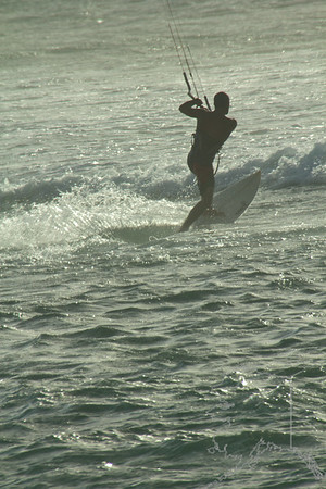 A wind kite surfer out having a great day.