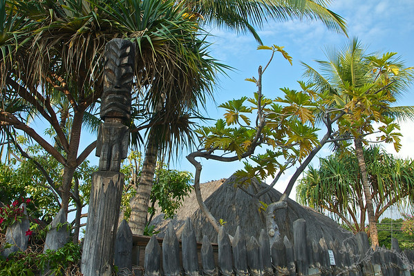 The three thatched houses at Hale Kahiko replicate part of an ancient Hawaiian village. The location at the back of a shopping center isn't without its irony, but the site nonetheless offers an insightful glimpse of Hawaiian life before Western development swept the landscape.  The buildings are authentically constructed of ohia-wood posts, native pili grass thatch and coconut-fiber lashings. The grounds are planted in native flora that Hawaiians relied upon for food and medicinal purposes. Each hale (house) had a different function; one was used as family sleeping quarters, one as a men's eating house, and the third as a workshop where women made tapa. Inside you'll find gourd containers, woven baskets, poi pounders and other essentials of Hawaiian life.  1