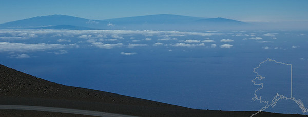 That is the Big Island of Hawaii seen from 10000 feet on top of Haleakala. 4 volcano's can be seen and the one to the far left is Mauna Kea. It is the second tallest mountain in the world. It is measured from the sea floor and stands 13,803 feet above sea level. Measured from its oceanic base, its height is 33,500 ft.