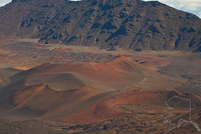 "Early Hawaiians applied the name Haleakalā (""house of the sun"") to the general mountain. Haleakalā is also the name of a peak on the south western edge of Kaupō Gap. In Hawaiian folklore, the depression at the summit of Haleakalā was home to the grandmother of the demigod Māui. According to the legend, Māui's grandmother helped him capture the sun and force it to slow its journey across the sky in order to lengthen the day. The tallest peak of Haleakalā, at 10,023 feetis Puʻu ʻUlaʻula (Red Hill).From the summit one looks down into a massive depression some(7 mi) across,(2 mi) wide, and nearly(2,600 ft) deep. The surrounding walls are steep and the interior mostly barren-looking with a scattering of volcanic cones.  The last eruption was in the 17th century."