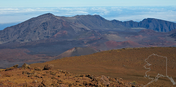 """Early Hawaiians applied the name Haleakalā (""""house of the sun"""") to the general mountain. Haleakalā is also the name of a peak on the south western edge of Kaupō Gap. In Hawaiian folklore, the depression at the summit of Haleakalā was home to the grandmother of the demigod Māui. According to the legend, Māui's grandmother helped him capture the sun and force it to slow its journey across the sky in order to lengthen the day. The tallest peak of Haleakalā, at 10,023 feetis Puʻu ʻUlaʻula (Red Hill).From the summit one looks down into a massive depression some(7 mi) across,(2 mi) wide, and nearly(2,600 ft) deep. The surrounding walls are steep and the interior mostly barren-looking with a scattering of volcanic cones.  The last eruption was in the 17th century."""