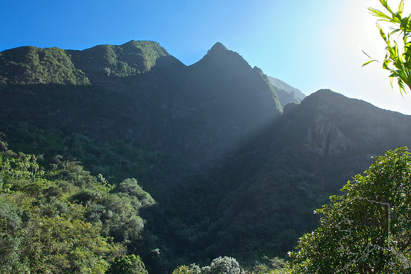 Towering emerald peaks guard the lush valley floor of Iao Valley State Park. Located in Central Maui just west of Wailuku, this peaceful 4,000-acre, 10-mile long park is home to one of Maui's most recognizable landmarks, the 1,200-foot Iao Needle. This iconic green-mantled rock outcropping overlooks Iao stream and is an ideal attraction for easy hiking and sightseeing. The sacred Iao Valley has great historical significance. It was here in 1790 at the Battle of Kepaniwai that King Kamehameha I clashed with Maui's army in his quest to unite the islands. Even with Iao Needle serving as a lookout point, Kamehameha defeated Maui's forces in a ferocious battle that ultimately changed the course of Hawaiian history.