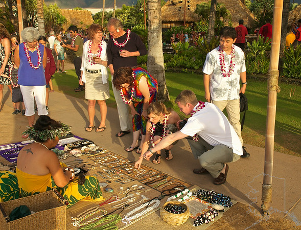 Old Lahaina Luau, Here Donnette (my wife in the multi colored outfit) and some close friends of ours are picking out some Hawaiian hand made jewelry.