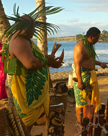 Native Hawaiian men sell their carvings at the Old Lahiana Luau.