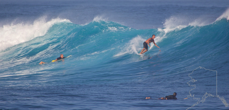 """For watching the surfers and epic surf, Ho'okipa Lookout is the place to be. The lookout is on the edge of a cliff overlooking """"Pavilions"""" – the popular surfing-end of the beach. Conditions permitting, more adventurous folks walk down toward the tip of the rocky outcropping, closer to the action."""