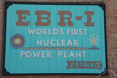 Experimental Breeder Reactor I (EBR-I) is a decommissioned research reactor and U.S. National Historic Landmark located in the desert about 18 miles (29 km) southeast of Arco, Idaho. At 1:50 p.m. on December 20, 1951, it became one of the world's first electricity-generating nuclear power plants when it produced sufficient electricity to illuminate four 200-watt light bulbs.EBR-I subsequently generated sufficient electricity to power its building, and continued to be used for experimental purposes until it wasdecommissioned in 1964. EBR-I was deactivated in 1964 and replaced with a new reactor, Experimental Breeder Reactor II. Landmark status for EBR-I was granted by President Lyndon Johnson and Glenn T. Seaborg on August 25, 1966.It was declared a National Historic Landmark in 1965and an IEEE Milestone in 2004.