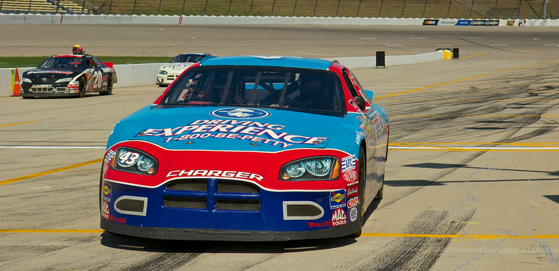 Richard Petty Driving Experience puts you in a NASCAR race car for an adrenaline pumping thrill of a lifetime that gets you as close to being in The Race as you will ever get! Program offerings are year-round, throughout over 20 tracks nationwide.  Choose from one of our Driving Experiences where your hands are on the wheel, your foot is on the gas and 600 horses are ready to take you for 8 to 50 laps around your favorite speedway. Rather let someone else do the driving? No problem! Ride-along shotgun from the passenger seat as one of our professional instructors takes you for 3 laps around the track at speeds up to 165mph.