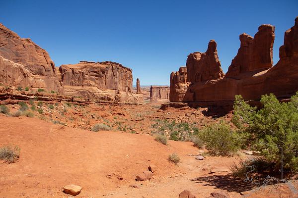 Arches National Park is a national park in eastern Utah, United States. The park is adjacent to the Colorado River, 4 miles north of Moab, Utah. More than 2,000 natural sandstone arches are located in the park, including the well-known Delicate Arch, as well as a variety of unique geological resources and formations. The park contains the highest density of natural arches in the world.  The park consists of 76,679 acres 119.811 sq miles of high desert located on the Colorado Plateau.The highest elevation in the park is 5,653 feet (1,723 m) at Elephant Butte, and the lowest elevation is 4,085 feet  at the visitor center. The park receives an average of less than 10 inches of rain annually.  Administered by the National Park Service, the area was originally named a national monument on April 12, 1929, and was re-designated as a national park on November 12, 1971. The park received more than 1.6 million visitors in 2018.