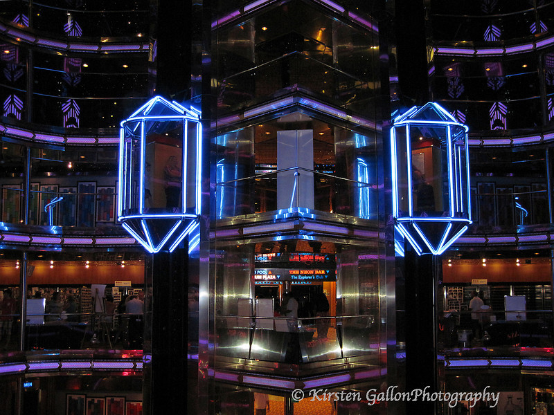 The very center of the ship is well lit with many colorful lights from the main lobby and up about four decks.