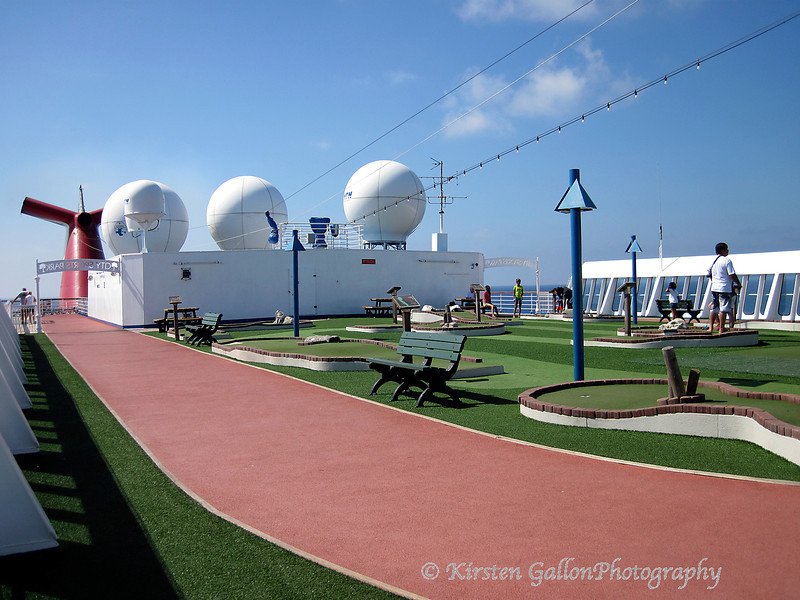 The top deck includes a running track and a miniature golf course.