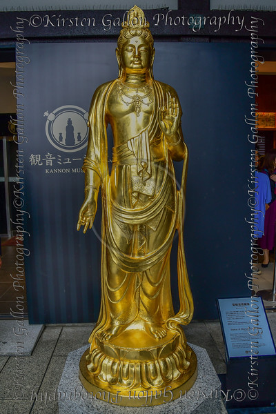 Golden statue at the entrance of Kannon Museum at Hase-dera temple, commonly called the Hase-kannon, one of the Buddhist temples in Kamakura, Kanagawa