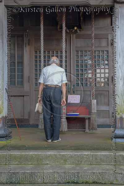 Japanese gentleman paying his respects.