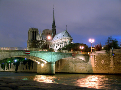 From the Seine, view of Notre Dame at night Paris, France