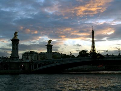 River cruise along the Seine with the Pont Alexandre III and Eiffel Tower in view at sunset