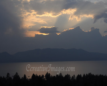 Visiting Reno and Lake Tahoe area. Lake Tahoe sunset through the window and from the 18th floor at Harrah's Casino.