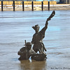 Somewhat flooded Statue of Lewis and Clark in the Mississippi River,