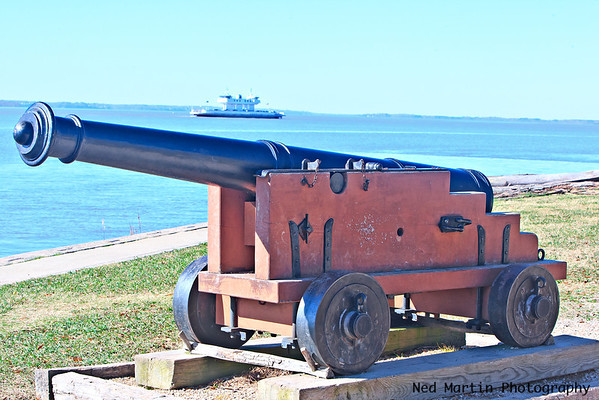 Cannon at Jamestown in front of the James and its ferry.