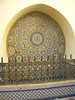 Wild central circle pattern on fountain - surrounded by floral motifs - Fes Medina